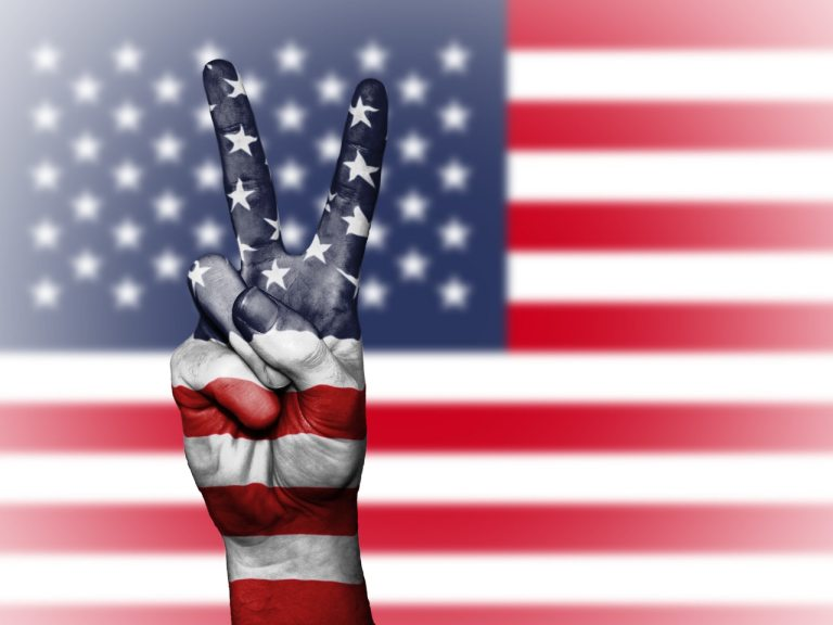 A peace sign in front of the USA flag