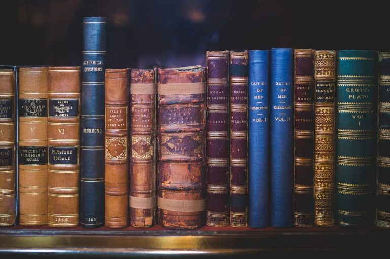 Old books line the shelves of a library in Oxford